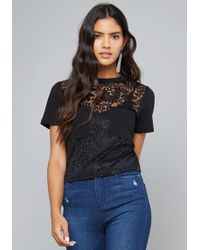 ade2445132 Lyst - Bebe Logo Lace Up Sleeve Top in Black