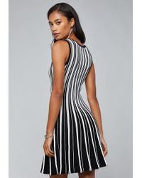 5010190b5bc Lyst - Bebe Miter Striped Dress in Black