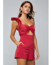Bebe - Ruffled One Shoulder Romper - Lyst