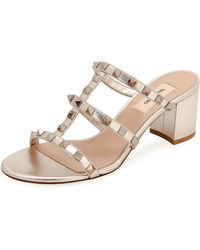 0c01834083 Valentino Rockstud Caged 60mm Slide Sandal in Natural - Lyst