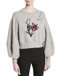 Oscar de la Renta - Cropped Cotton Sweatshirt With Bird-coral Embroidery - Lyst