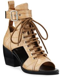 45dc866d7 Chloé Python-embossed Leather Combat Boot in Brown - Lyst