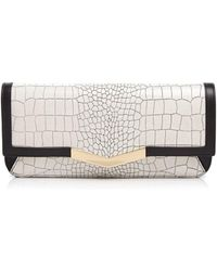 Time's Arrow - Embossed Gya Clutch - Lyst