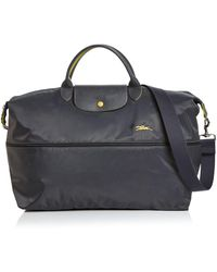c6e60feaa Longchamp Personalized Le Pliage Travel Bag in Blue - Lyst