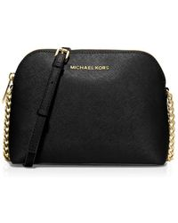 f21cad27d1fc4 Lyst - Michael Michael Kors Cindy Patent Dome Cross-body Bag in Natural
