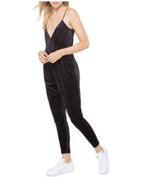 Juicy Couture | Track Velour Crossover Jumpsuit | Lyst
