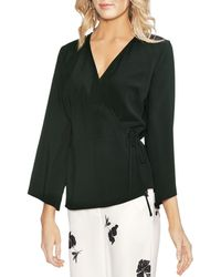 03501041cc2a Vince Camuto Mock-neck Cutout Top in White - Lyst