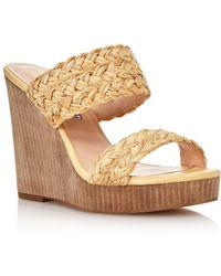 82150adf22ea Lyst - Manolo Blahnik Susa Raffia Wedge Sandals in Natural