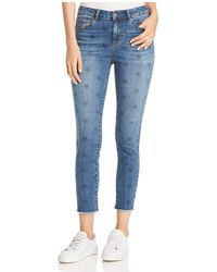Aqua - Star Print Skinny Jeans - Lyst