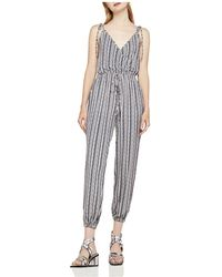 BCBGeneration - Striped Crossover Jumpsuit - Lyst