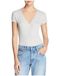 Olivaceous - V-neck Rib-knit Bodysuit - Lyst