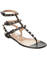ad46fb72baa9 Lyst - Valentino Rockstud Leather Ankle Wrap Flat Sandal in Red
