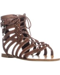 827d1f27152a Lyst - Guess Mannie Flat Gladiator Sandals in Metallic