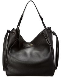 908ee860b9ea Lyst - Prada Pebbled Leather Saddle Bag in Black