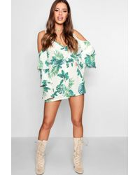 Boohoo - Petite Cathy Palm Print Ruffle Sleeve Wrap Playsuit - Lyst