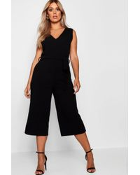 981bd2c61cd Boohoo Plus Anya Cold Shoulder Culotte Jumpsuit in Black - Lyst