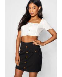 da7e0f56d9 Boohoo Paperbag Waist Mock Horn Button Skater Skirt in Black - Lyst