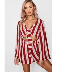 cd7f90f13f7 Boohoo One Shoulder Flare Sleeve Chain Print Playsuit in Red - Lyst