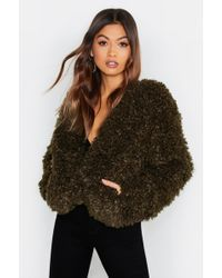 749e52757f4 Boohoo Pocket Front Teddy Faux Fur Coat in Yellow - Lyst