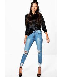 31e5bb100b Lyst - Boohoo Mid Rise Distressed Rip Knee Skinny Jeans in Blue