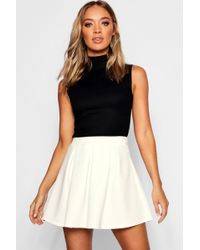 Boohoo - Basic Box Pleat Skater Mini Skirt - Lyst