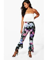 Boohoo - Bright Floral Dipped Hem Skinny Trousers - Lyst
