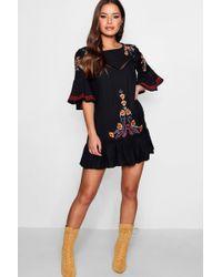 Boohoo - Petite Embroidered Flare Sleeve Smock Dress - Lyst