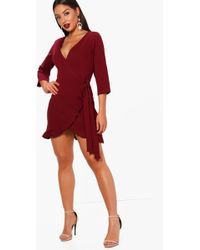 91646be31dd4 Boohoo Textured Wrap Detail Dress in Pink - Lyst