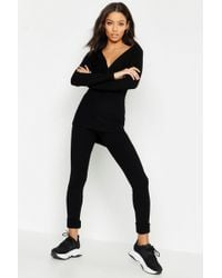 4cf6674df2e3 Missguided Black Hooded Fishnet Jumpsuit in Black - Lyst