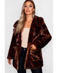 8b5b55719ad Boohoo Plus Short Button Faux Fur Teddy Coat in Yellow - Lyst