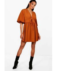 Boohoo - Lace Up Front Angel Sleeve Skater Dress - Lyst
