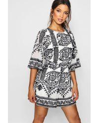 daef01ad22 Lyst - Boohoo Boutique Lara Angel Sleeve Embellished Playsuit in Black