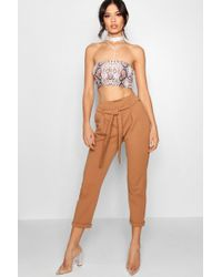 Boohoo - Lucy Paper Bag Waist Tapered Trouser - Lyst