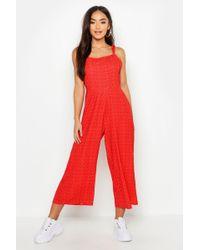 cddc8f6624 Boohoo - Petite Woven Spot Tie Strap Culotte Jumpsuit - Lyst