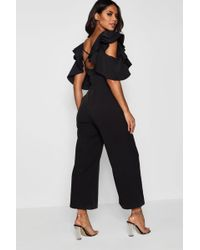Boohoo - Statement Ruffle Cross Back Jumpsuit - Lyst