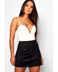 cfc1c76ee3 Boohoo Katiah Ring Detail Suedette Asymetric Mini Skirt in Black - Lyst