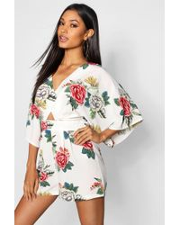 ee663e1323 Boohoo Large Floral Drape Front Playsuit in White - Lyst