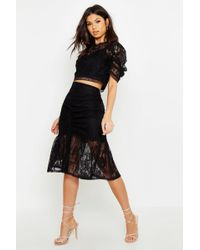 4dee738dc Boohoo Petite Millie Ruched Side Asymmetric Midi Skirt in Black - Lyst