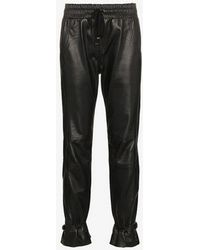SKIIM - Gaby High-waisted Leather Track Pants - Lyst