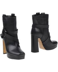 Pollini Black Ankle Boots - Lyst