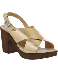 Office Wolf Cross Strap Sandal gold - Lyst