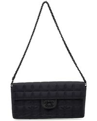 Chanel Pre-Owned Black Travel Line Flap Bag - Lyst