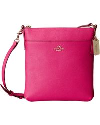 Coach Emb Txt Leather Ns Swingpack pink - Lyst