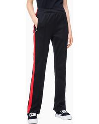 9473b245bd9a1f Calvin Klein Monogram Badge High-rise Cotton-jersey jogging Bottoms ...