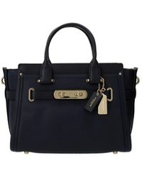 COACH - Handbags Swagger Women Blue - Lyst