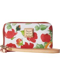 Dooney & Bourke Coated Cotton Rose Garden Zip Around Credit Card Phone Wristlet - Lyst
