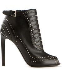 Alexander McQueen Black Leather Studded Ankle Boots - Lyst