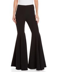 MILLY - Crepe Flared Pants - Lyst