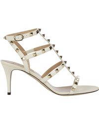 fed22a0f234 Lyst - Valentino Rockstud Leather Gladiator Heels T.100 in White