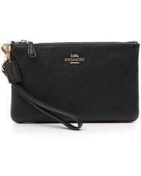 COACH - Logo Embossed Zip Pouch - Lyst